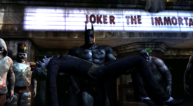 batman carrying joker